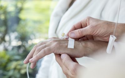 Close-up of a hand with a peripheral venous access catheter